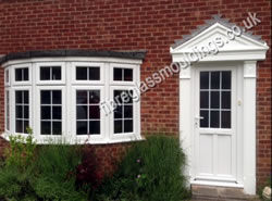 Fluted Door Surround & Apex Canopy